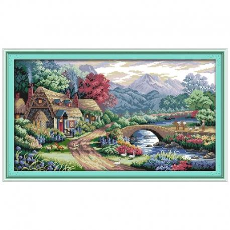 piękny pejzaż domem i rzeką do haftu